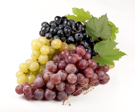 black, green, red bunch of grapes close up, on white background,