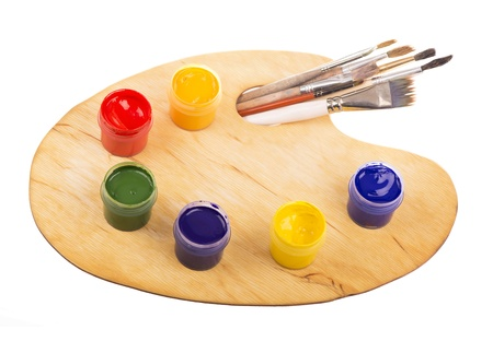 Palette with paints and brushes of the artist on the white Stock Photo - 19363410