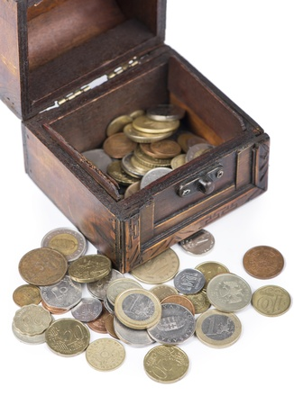 Wooden casket full of coins thai photo