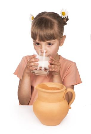 milk mustache: Little girl drinking milk Stock Photo