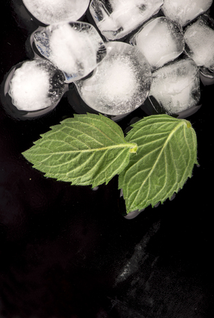 ice cubes, mint leaf on black Stock Photo - 26415958
