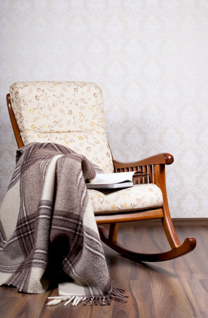 modern rocking chair near a light wall Imagens