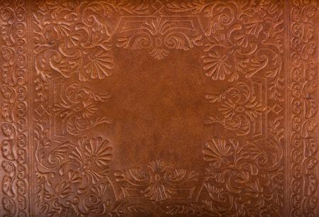 革の花柄のパターンの背景をクローズ アップ