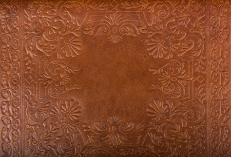 tooled leather: Leather floral pattern di sfondo close up