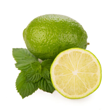 Fresh limes, mint leaves isolated on white photo