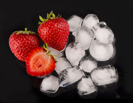 ice cubes, mint leaf,  fresh strawberry on black Stock Photo - 26400596