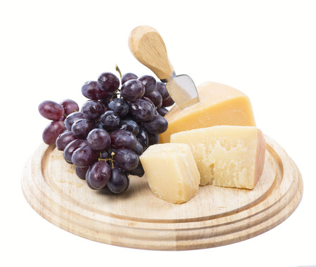 cheese and fruit on a white background photo