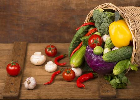 health food: Healthy Organic Vegetables on a Wooden Background. Frame Design
