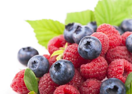 varied: Many blueberries, raspberries  Isolated white
