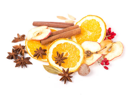 Christmas spices and dried orange sliceson photo