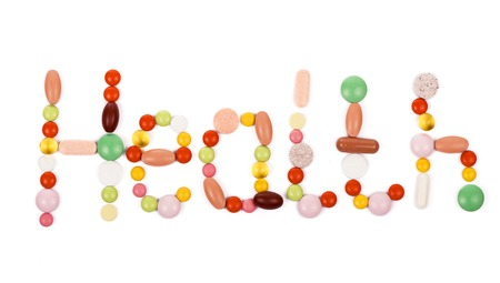 inflammatory: health inscription made from colorful pills isolated on white