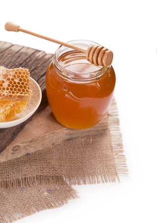 drizzler: glass pot with floral honey isolated on white background Stock Photo
