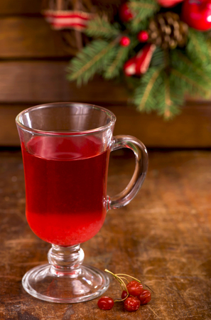 Still life with viburnum tea on wooden background Stock Photo