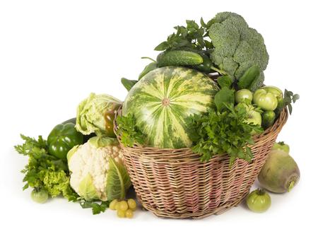 Green vegetables in wicker basket Stock Photo