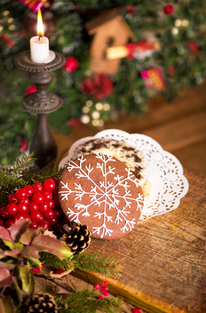 Christmas decoration with cookies on an old wooden background.