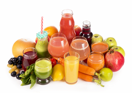 Glasses with fresh organic vegetable and fruit juices isolated on white. Stock Photo