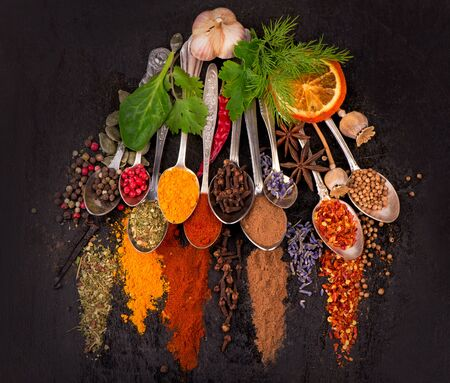 Spices and condiments for cooking on a black background Imagens - 128889976