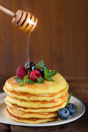 Stack of pancakes with fresh berries, close-up