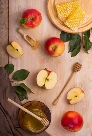 Jewish holiday Rosh Hashana background with apples, honey on blackboard. View from above. Flat lay