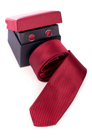 Red silk business tie rolled up over white background.