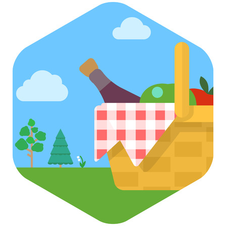 grassy: Basket for picnic with wine and fruit against grassy meadow.