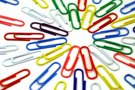 Color paper clips on a white background laying beams from the center. Stock Photo - 6913341