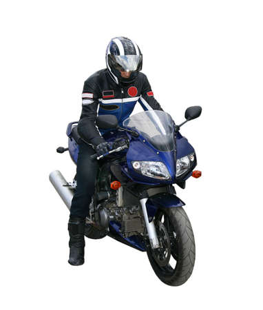 motorcyclist: The motorcyclist in a helmet and a jacket goes on a motorcycle. Stock Photo