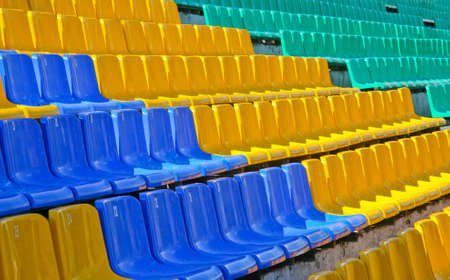 Colour plastic seats on  stadium tribune outside Stock Photo - 6995446