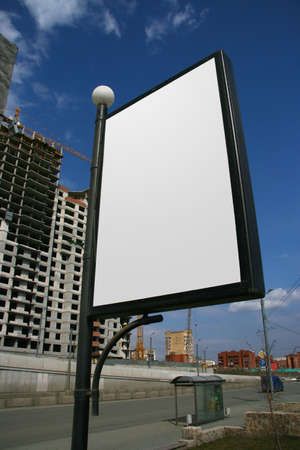 Publicity board in  street in city centre. photo