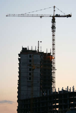 Construction of a high multiroom residential building on a sunset. Stock Photo - 7068002