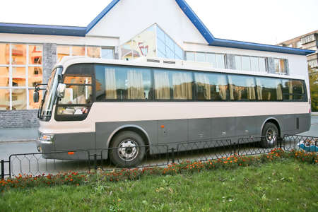 bus station: The bus at bus station before a building Stock Photo
