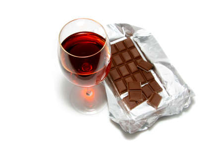 red wine glasses: Glass fault and chocolate on a white background.