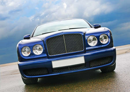 big prestigious dark blue car against the sky photo