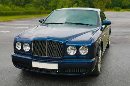 the case before:  beautiful prestigious modern dark blue car on the area