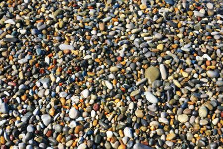 Smooth, beautiful, wet, brilliant, sea pebbles on seacoast. Stock Photo - 12332016