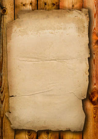fragmentary: Old paper with fragmentary edges on old boards