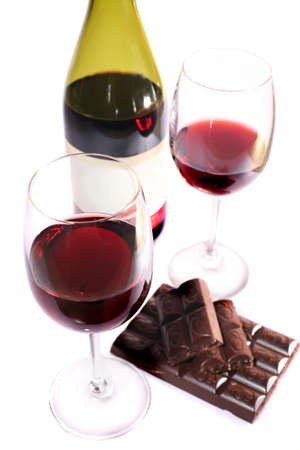 white wine glass: Two wine glasses of wine chocolate and  bottle  isolated Stock Photo