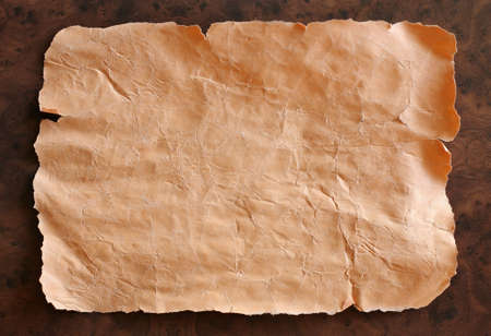 clr: Old crushed paper on brown background