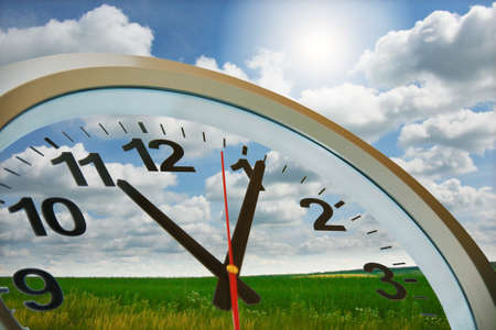 clock  circle against  beautiful summer landscape. photo