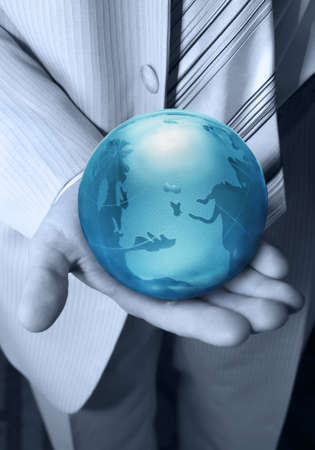 Globe glass blue in hands at the businessman