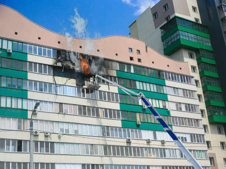 building on fire: Fire in apartment of  multiroom apartment house