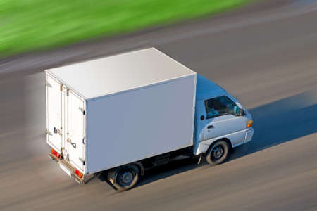 moving van:  truck with  white van moves on road