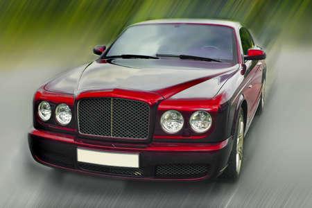 the case before:  beautiful prestigious modern dark red car on the area Stock Photo