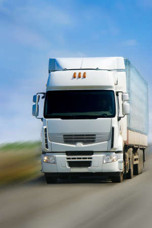 goes:  truck with white cabin goes on road