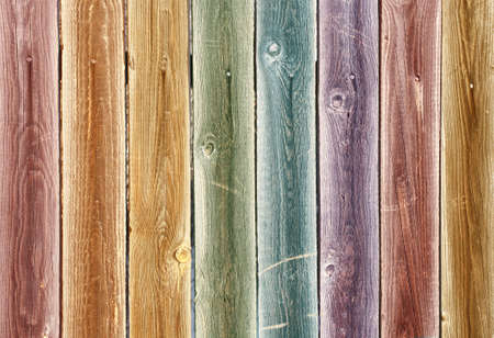 Background of multi-coloured vertical wooden boards
