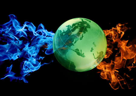 green globe against abstract water and fire photo