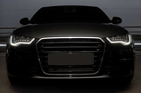 car front: beautiful black powerful sports car