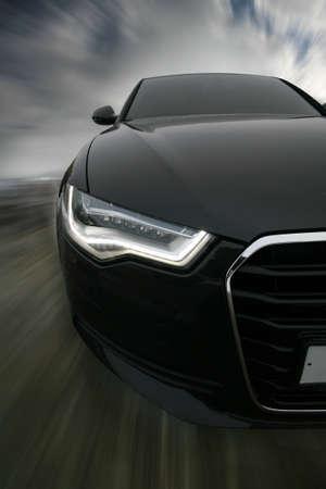 мощный спортивный автомобиль выходит на дороги Фото со стока