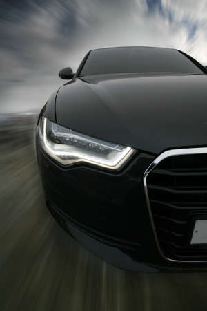 headlights: powerful sports car goes on road