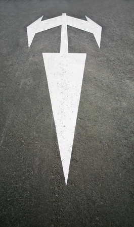 road marking white arrow in three directions photo